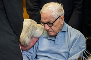Charlene Marshall, wife of Anthony Marshall, cries on her husband's shoulder before his sentencing at Manhattan Criminal Courts on June 21, 2013 in New York City. Anthony Marshall, age 89 and son of Brooke Astor, was found guilty of stealing millions from his mother's estate, and has been sentenced to serve one year of his three year term.