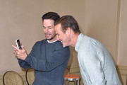 "Mark Wahlberg and Peter Berg attend a photo call for STX Films' ""Mile 22"" at Four Seasons Hotel Los Angeles at Beverly Hills on July 28, 2018 in Los Angeles, California."