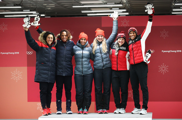 Bobsleigh - Winter Olympics Day 12 [red,social group,team,stage equipment,event,technology,talent show,competition,performance,elana meyers taylor,lauren gibbs,l-r,gold,silver,bronze,united states,canada,womens bobsleigh,winter olympics]
