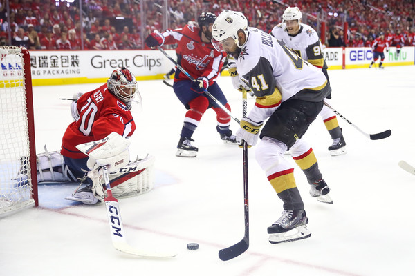 2018 NHL Stanley Cup Final - Game Three [player,college ice hockey,ice hockey,ice hockey position,sports,hockey protective equipment,sports gear,team sport,hockey,defenseman,pierre-edouard bellemare,braden holtby,three,game,net,capital one arena,nhl,washington capitals,vegas golden knights,stanley cup final]