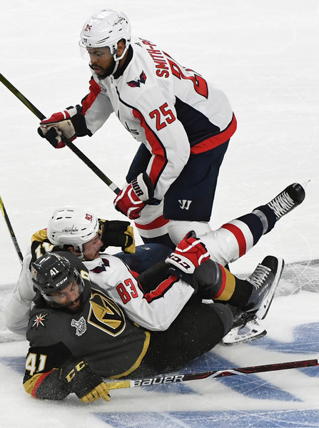 2018 NHL Stanley Cup Final - Game One [sports,sports gear,ice hockey,ice hockey equipment,hockey protective equipment,ice hockey position,hockey pants,player,team sport,hockey,game one,each other,pierre-edouard bellemare,jay beagle,devante smith-pelly 25,nhl,vegas golden knights,washington capitals,capitals,stanley cup final]