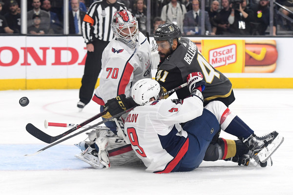 2018 NHL Stanley Cup Final - Game Five [player,college ice hockey,ice hockey,sports gear,ice hockey position,sports,ice hockey equipment,hockey protective equipment,team sport,goaltender,pierre-edouard bellemare,dmitry orlov 9,five,shot,braden holtby 70,t-mobile arena,nhl,vegas golden knights,washington capitals,stanley cup final]