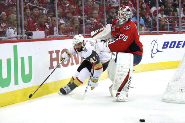 2018 NHL Stanley Cup Final - Game Three [player,college ice hockey,ice hockey position,sports,hockey protective equipment,ice hockey,sports gear,team sport,defenseman,hockey,pierre-edouard bellemare,braden holtby,three,game,game three,capital one arena,nhl,washington capitals,vegas golden knights,stanley cup final]