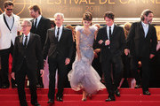 """(L-R) Actors Geoffrey Rush, producer Jerry Bruckheimer, guest, Penelope Cruz, director Rob Marshall, and Ian McShane attend the """"Pirates of the Caribbean: On Stranger Tides"""" premiere at the Palais des Festivals during the 64th Cannes Film Festival on May 14, 2011 in Cannes, France."""