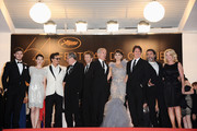"""(L-R) Sam Claflin, Astrid Berges-Frisbey, Johnny Depp, Geoffrey Rush, Jerry Bruckheimer, guest, Penelope Cruz, Rob Marshall and Ian McShane depart the """"Pirates of the Caribbean: On Stranger Tides"""" premiere at the Palais des Festivals during the 64th Cannes Film Festival on May 14, 2011 in Cannes, France."""