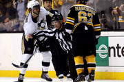 Brad Marchand #63 of the Boston Bruins and Kris Letang #58 of the Pittsburgh Penguins are separated by linesman Brian Murphy #93 during Game Three of the Eastern Conference Final of the 2013 NHL Stanley Cup Playoffs at the TD Garden on June 5, 2013 in Boston, Massachusetts.