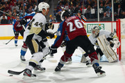 Paul Stastny #26 of the Colorado Avalanche tries to control the puck against Brooks Orpik #44 of the Pittsburgh Penguins as goalie Marc-Andre Fleury #29 of the Pittsburgh Penguins defends the goal at the Pepsi Center on March 3, 2012 in Denver, Colorado. The Penguins defeated the Avalanche 5-1.