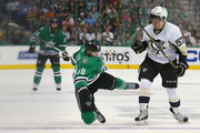 Jason Spezza #90 of the Dallas Stars collides with David Perron #57 of the Pittsburgh Penguins in the first period at American Airlines Center on October 8, 2015 in Dallas, Texas.