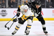 Sidney Crosby #87 of the Pittsburgh Penguins skates after the puck with Adrian Kempe #9 of the Los Angeles Kings during the first period at Staples Center on January 18, 201 in Los Angeles, California.