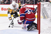 Bryan Rust #17 of the Pittsburgh Penguins skates the puck towards goaltender Antti Niemi #37 of the Montreal Canadiens during the NHL game at the Bell Centre on October 13, 2018 in Montreal, Quebec, Canada.  The Montreal Canadiens defeated the Pittsburgh Penguins 4-3 in a shootout.