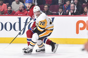 Patric Hornqvist #72 of the Pittsburgh Penguins and Jonathan Drouin #92 of the Montreal Canadiens skate after the puck during the NHL game at the Bell Centre on October 13, 2018 in Montreal, Quebec, Canada.