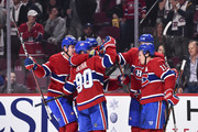 Tomas Tatar #90 of the Montreal Canadiens celebrates his second period goal with teammates against the Pittsburgh Penguins during the NHL game at the Bell Centre on October 13, 2018 in Montreal, Quebec, Canada.