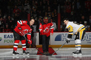 Patrick Warburton who played the part of David Putty on the TV show Seinfeld drops the puck between Andy Greene #6 of the New Jersey Devils and Sidney Crosby #87 of the Pittsburgh Penguins at the Prudential Center on February 19, 2019 in Newark, New Jersey.