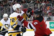 Patric Hornqvist #72 of the Pittsburgh Penguins skates against John Moore #2 of the New Jersey Devils at the Prudential Center on March 29, 2018 in Newark, New Jersey. The Penguins defeated the Devils 4-3 in overtime.
