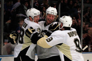 Brent Johnson #1 of the Pittsburgh Penguins is congratulated by his teammates for his first period goal against the New York Rangers at Madison Square Garden on February 13, 2011 in New York City.