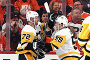 Patric Hornqvist #72 of the Pittsburgh Penguins (l) celebrates his second period goal against the Philadelphia Flyers and is joined by Jake Guentzel #59 (r) in Game Six of the Eastern Conference First Round during the 2018 NHL Stanley Cup Playoffs at the Wells Fargo Center on April 22, 2018 in Philadelphia, Pennsylvania.