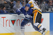 Patric Hornqvist #72 of the Pittsburgh Penguins checks Mitchell Marner #16 of the Toronto Maple Leafs during an NHL game at Scotiabank Arena on October 18, 2018 in Toronto, Ontario, Canada. The Penguins defeated the Maple Leafs 3-0.