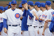 Anthony Rizzo #44 of the Chicago Cubs (L) greets teammates during player rintroductions before the Opening Day home game against the Pittsburgh Pirates at Wrigley Field on April 10, 2018 in Chicago, Illinois.