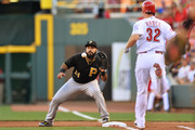 Pedro Alvarez #24 of the Pittsburgh Pirates takes the throw at first base to force Jay Bruce #32 of the Cincinnati Reds out in the first inning at Great American Ball Park on July 30, 2015 in Cincinnati, Ohio.