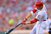 Joey Votto #19 of the Cincinnati Reds hits a single in the first inning against the Pittsburgh Pirates at Great American Ball Park on July 30, 2015 in Cincinnati, Ohio. Vote would go on to score.