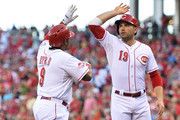 Chris Stewart #19 of the Pittsburgh Pirates congratulates Marlon Byrd #9 of the Cincinnati Reds at home plate after Byrd's three-run home run in the first inning against the Pittsburgh Pirates at Great American Ball Park on July 30, 2015 in Cincinnati, Ohio.