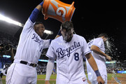 Salvador Perez #13 of the Kansas City Royals douses Mike Moustakas #8 and Eric Hosmer #35 with water as they celebrate a 5-1 win over the Pittsburgh Pirates at Kauffman Stadium on July 22, 2015 in Kansas City, Missouri.