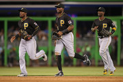 Outfielders Starling Marte #6, Gregory Polanco #25 and Andrew McCutchen #22 of the Pittsburgh Pirates run off the field after defeating the Miami Marlins in the game at Marlins Park on August 27, 2015 in Miami, Florida.