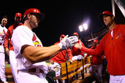 Manager Mike Matheny #22 of the St. Louis Cardinals congratulates Matt Holliday #7 of the St. Louis Cardinals after he hit a solo home run against the Pittsburgh Pirates in the seventh inning at Busch Stadium on September 30, 2016 in St. Louis, Missouri.