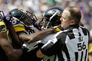 Side judge Allen Baynes #56 tries to seperate William Gay #22 of the Pittsburgh Steelers (L) and Torrey Smith #82 of the Baltimore Ravens (R) during an altercation during the season opener at M&T Bank Stadium on September 11, 2011 in Baltimore, Maryland.