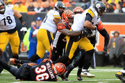 Vontaze Burfict #55 of the Cincinnati Bengals and Shawn Williams #36 combine to tackle James Conner #30 of the Pittsburgh Steelers during the second quarter at Paul Brown Stadium on October 14, 2018 in Cincinnati, Ohio.
