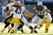 Running back Chris Ivory #23 of the New York Jets looks for an opening as linebacker Jason Worilds #93 and safety Troy Polamalu #43 of the Pittsburgh Steelers close in during the third quarter during a game at MetLife Stadium on October 13, 2013 in East Rutherford, New Jersey. The Steelers defeated the Jets 19-6.