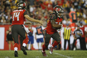 Quarterback Ryan Fitzpatrick #14 of the Tampa Bay Buccaneers hands off to running back Jacquizz Rodgers #32 during the second quarter of a game against the Pittsburgh Steelers on September 24, 2018 at Raymond James Stadium in Tampa, Florida.