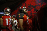 Quarterback Ryan Fitzpatrick #14 of the Tampa Bay Buccaneers and wide receiver Mike Evans #13 wait in the tunnel at the start of a game against the Pittsburgh Steelers on September 24, 2018 at Raymond James Stadium in Tampa, Florida.