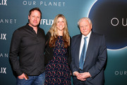 "Jamie McPherson, Sophie Lanfear and Sir David Attenborough attend the ""Our Planet"" Special Screening With Sir David Attenborough at the Smithsonian National Museum Of American History on April 10, 2019 in Washington, DC."