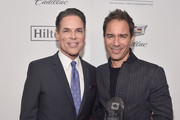 Jorge Valencia, Executive Director & CEO of Point Foundation (L), and Point Impact Award Honoree Eric McCormack pose backstage at Point Foundation?s Point Honors gala at The Beverly Hilton Hotel on October 13, 2018 in Beverly Hills, California.