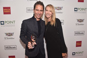 Point Impact Award Honoree Eric McCormack (L) and Janet Holden pose backstage at Point Foundation?s Point Honors gala at The Beverly Hilton Hotel on October 13, 2018 in Beverly Hills, California.