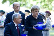 German Chancellor Angela Merkel (R) and President of Poland Lech Kaczynski light candles during a remembrance of the German invasion in Poland in 1939 at the cemetary of defenders on September 1, 2009 at Westerplatte Monument in Gdansk, Poland. Today, Merkel and european leaders attend a ceremony marking the 70th anniversary of the start of World War II.
