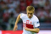 Jakub Blaszczykowski of Poland runs with the ball during the UEFA EURO 2012 group A match between Poland and Russia at The National Stadium on June 12, 2012 in Warsaw, Poland.