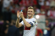 Jakub Blaszczykowski of Poland applauds the fans during the UEFA EURO 2012 group A match between Poland and Russia at The National Stadium on June 12, 2012 in Warsaw, Poland.