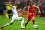Andrey Arshavin of Russia is put under pressure by Jakub Blaszczykowski of Poland during the UEFA EURO 2012 group A match between Poland and Russia at The National Stadium on June 12, 2012 in Warsaw, Poland.