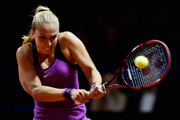 Sabine Lisicki of Germany plays a backhand in her match against Timea Babos of Hungary during Day 1 of the Porsche Tennis Grand Prix at Porsche-Arena on April 18, 2016 in Stuttgart, Germany.