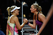 Angelique Kerber of Germany shakes hands with Petra Kvitova of Czech Republic during Day 6 of the Porsche Tennis Grand Prix at Porsche-Arena on April 23, 2016 in Stuttgart, Germany.