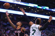 Damian Lillard #0 of the Portland Trail Blazers makes a shot against Jared Sullinger #7 of the Boston Celtics during the first quarter at TD Garden on March 2, 2016 in Boston, Massachusetts.