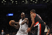Kevin Garnett #2 of the Brooklyn Nets drives against LaMarcus Aldridge #12 of the Portland Trail Blazers during the second half at Barclays Center on November 18, 2013 in the Brooklyn borough of New York City. The Trail Blazers defeat the Nets 108-98.  NOTE TO USER: User expressly acknowledges and agrees that, by downloading and/or using this photograph, user is consenting to the terms and conditions of the Getty Images License Agreement.