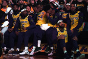 Lebron James and Quinn Cook cry during the Los Angeles Lakers pregame ceremony to honor Kobe Bryant before the game against the Portland Trail Blazers at Staples Center on January 31, 2020 in Los Angeles, California.