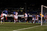 Kanu of Portsmouth rises to head home Portsmouth's first goal during the Barclays Premier League match between Portsmouth and Birmingham City at Fratton Park on March 9, 2010 in Portsmouth, England.