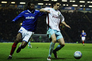 Michael Duff of Burnley holds off Kanu of Portsmouth during the npower Championship match between Portsmouth and Burnley at Fratton Park on January 25, 2011 in Portsmouth, England.