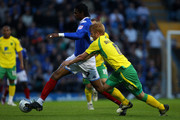 Kanu of Portsmouth is challeneged by Zak Whitbread of Norwich City during the npower Championship match between Portsmouth and Norwich City at Fratton Park on May 2, 2011 in Portsmouth, England.