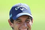 Matteo Manassero of Italy shares a joke on the range ahead of the Portugal Masters at Dom Pedro Victoria Golf Course on September 18, 2018 in Albufeira, Portugal.