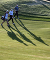 Colin Montgomerie of Scotland (centre) walks with his caddie Jason Hempelman and Lee Westwood of England (right) on the tenth hole during the first round of the Portugal Masters at the Oceanico Victoria Golf Course on October 15, 2009 in Vilamoura, Portugal.